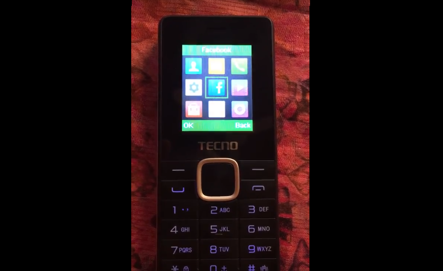 Mobile phone with Facebook tile in center of the screen